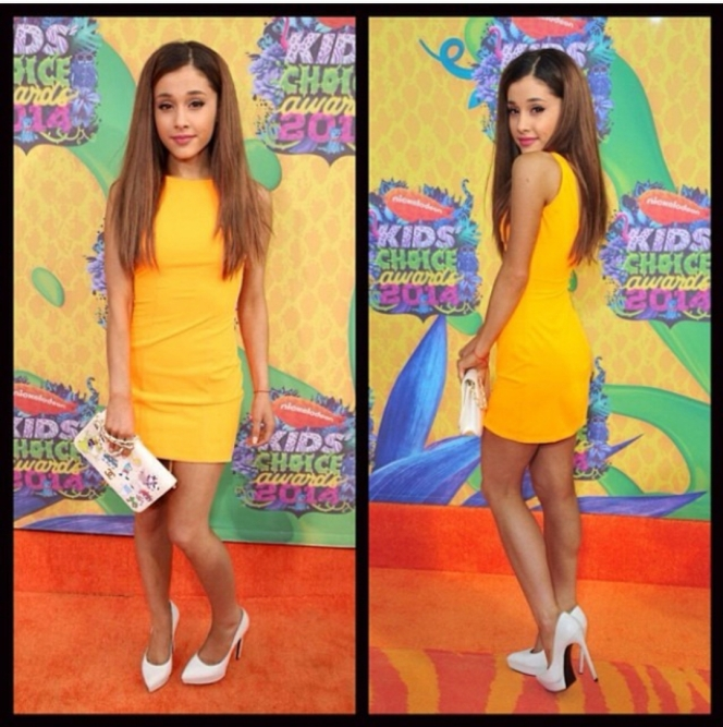 Ariana Grande wore Aiisha Ramadan Orange Mini Dress (not available online), a Chanel White Quilted Flap Bag which she decorated with decals of Nickelodeon cartoon characters, and a pair of Saint Laurent 130MM Janis Leather Pumps